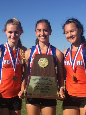 Central High School seniors Olivia Dabbert (left to right), Bailey Kinney and Daniela Munoz led the Lady Cats cross country team to its first district championship since 2011, the last year it was a two-mile course.