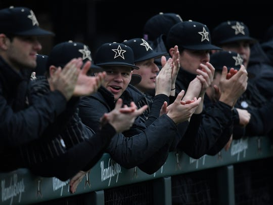 The Vanderbilt bench cheers for their teammate during the game against Duke at Hawkins Field Friday, Feb. 16, 2018 in Nashville, Tenn.