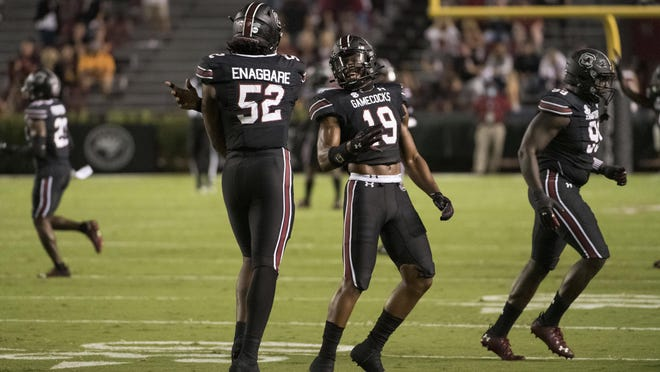 South Carolina linebacker Brad Johnson (19) and defensive lineman Kingsley Enagbare (52) celebrate a stop against Tennessee during the first half of an NCAA college football game Saturday, Sept. 26, 2020, in Columbia, S.C.