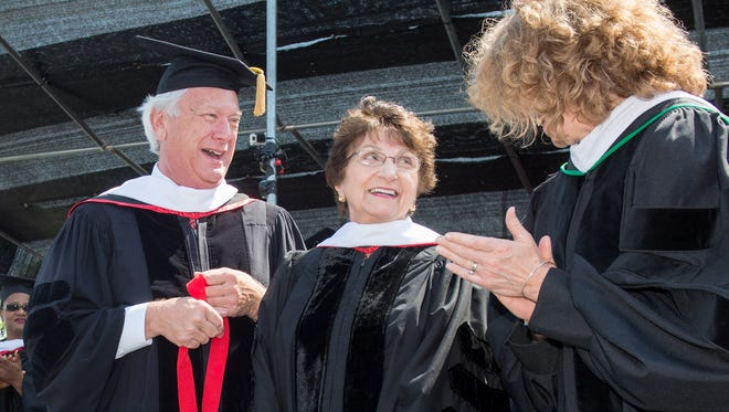 University of Indianapolis Board of Trustees Chairman Thomas Martin (left) and College of Arts & Sciences Dean Jennifer Drake (far right) honor UIndy Trustee Yvonne Shaheen on Saturday, May 2, 2015. Shaheen donated $5 million to support UIndy's College of Arts & Sciences, which is being renamed the Riad and Yvonne Shaheen College of Arts & Sciences, after her and her late husband.