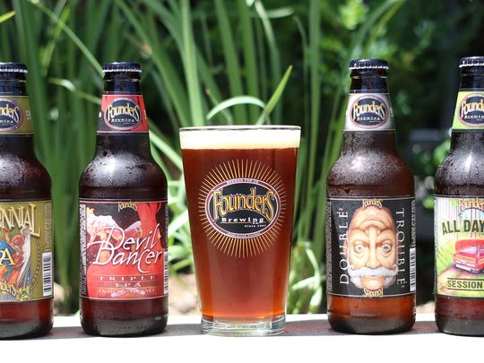 From left, Centennial IPA, Devil Dancer Triple IPA, a glass of beer, Double Trouble, and All Day IPA Session Ale from Founders Brewing. Canal Street Brewing Co., LLC (dba Founders Brewing Co.) began in Grand Rapids in 1997 as a small tap room and small beer production facility.