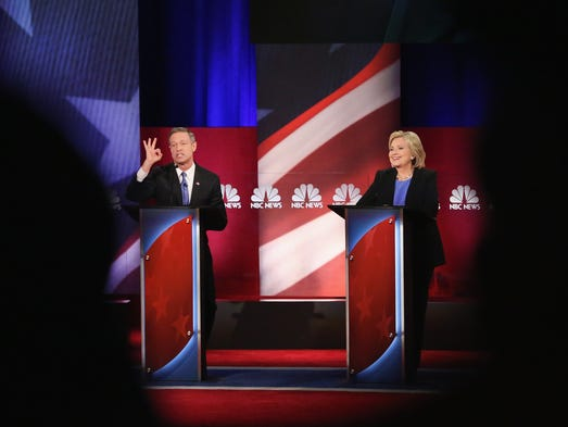 Martin O'Malley and Hillary Clinton participate in