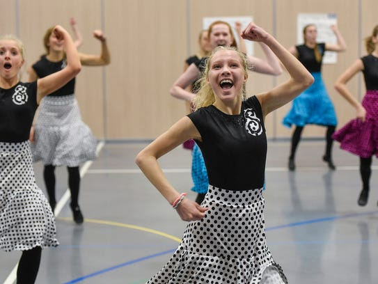 Sartell Dance Team members rehearse a portion of a