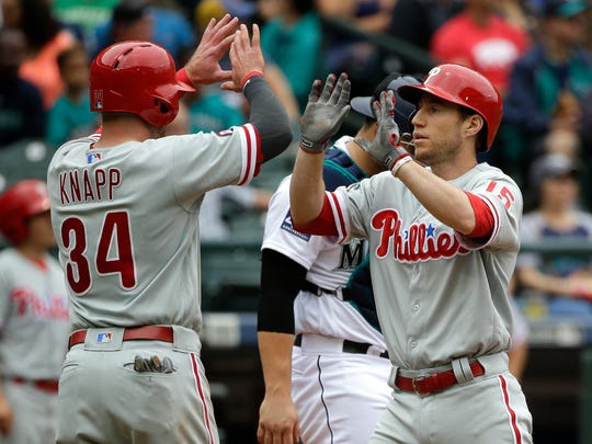 Philadelphia Phillies' Ty Kelly, right, is greeted at the plate by teammate Andrew Knapp (34) after Kelly hit a home run in the third inning.