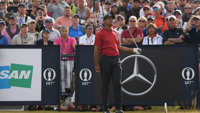 Tiger Woods reacts to his tee shot on the 18th hole during the final round of the 147th Open Championship at Carnoustie Golf Club in Scotland.