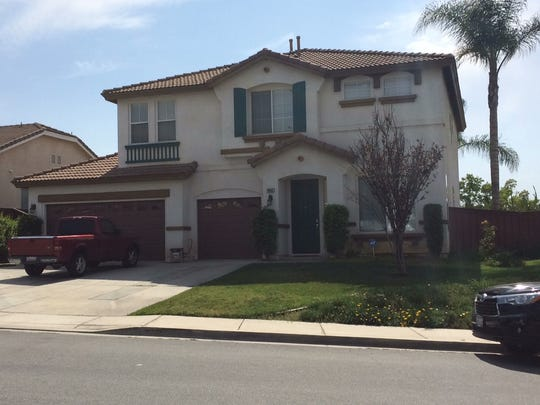 The home of Cedric Anderson, the suspected gunman in the San Bernardino school shooting, is seen in a gated community in nearby Riverside on Tuesday, a day after police searched the house.