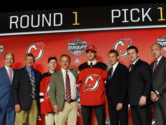 Nico Hischier poses for photos after being selected