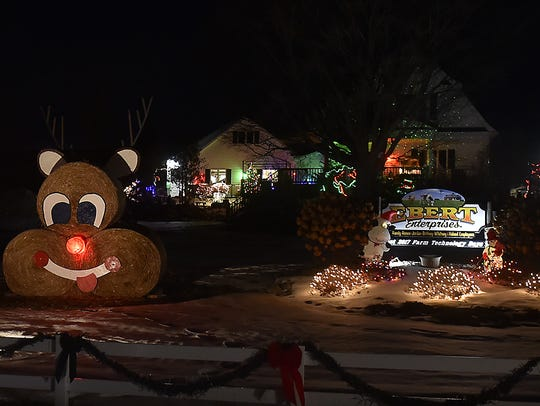 A snowman and Rudolph were created with round hay bales