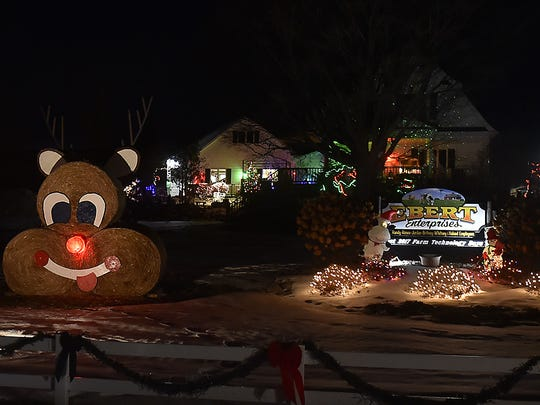 A snowman and Rudolph were created with round hay bales at Ebert Enterprises, N6939 County Road D, Algoma. It took first place in the Business Classic category.