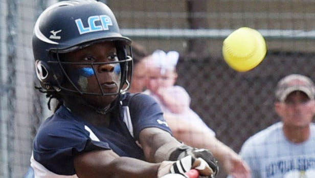 Loyola's Kassidy Moore hits the ball during their game against Vanderbilt Catholic in the LHSAA Division II state softball playoff game Friday.