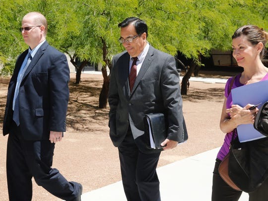 Former EPISD Associate Superintendent James Anderson, left, and former Austin High School Assistant Principal Nancy Love, right, are among five former administrators facing trial Monday. Anderson's attorney, Robert J. Perez, is shown at center.