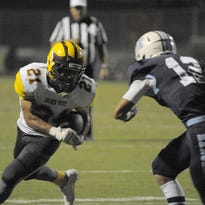 Golden West's Cristian Canales runs the football against Redwood in a West Yosemite League game.