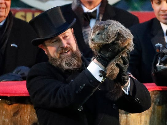 Punxsutawney Phil predicted six more weeks of winter Friday.