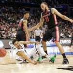 Georgia's Cameron Forte (11) and Michigan State's Bryn Forbes (5) watch a ball go out of bounds during the second half of an NCAA tournament college basketball game in the Round of 64 in Charlotte, N.C., March 20.