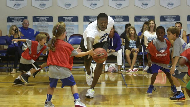 Former University of Kentucky All-Star and current NBA player Julius Randle loses the ball during John Calipari's basketball camp at Sports of all Sorts in Florence on Tuesday.