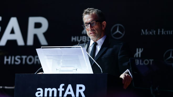 Kenneth Cole  speaks during the amfAR Milano 2013 Gala Auction as part of Milan Fashion Week on Sept. 21 in Italy.