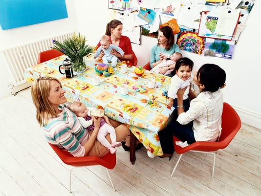 Group of Mothers and Their Offspring Sitting Around a Table