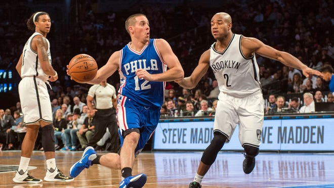 Oct. 18, 2015; Brooklyn, N.Y.; Philadelphia 76ers point guard T.J. McConnell (12) drives to the basket with Brooklyn Nets point guard Jarrett Jack (2) defending during the second quarter at Barclays Center.