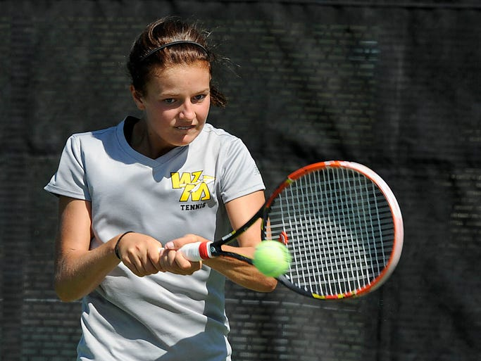 Watkins Memorial's first singles player Alexis Steer plays Granville's Charlotte Purnode during the Licking County girls tennis tournament on Saturday, Aug. 16, 2014, at Denison University.
