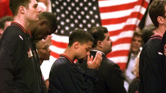 Denver Nuggets point guard Mahmoud Abdul-Rauf on March 15, 1996 - his first game back after ending his pre-game refusal to stand for the national anthem.
