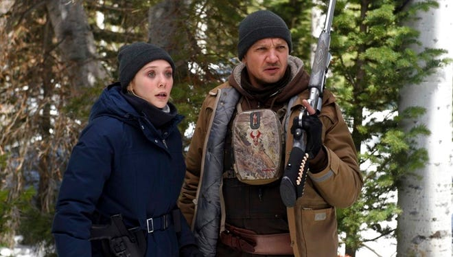 "This image released by The Weinstein Company shows Elizabeth Olsen, left, and Jeremy Renner in a scene from ""Wind River."""
