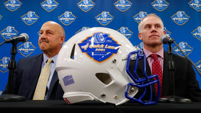 Boston College football coach Steve Addazio, left, and Maryland coach D.J. Durkin speak at a news conference in Allen Park on Dec. 7, 2016.