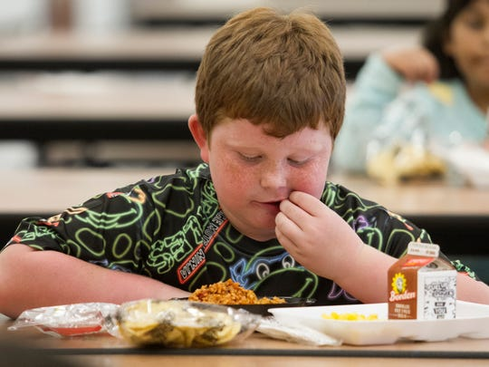 Ethan Peterson eats after school on Thursday at Ray