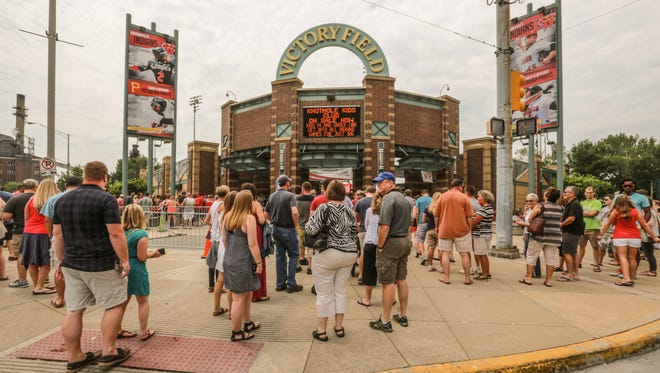 Crowds wait to enter at the Bacon and Beer Classic festival at Victory Field, Saturday July 11th, 2015.