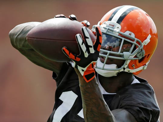 Cleveland Browns wide receiver Josh Gordon makes a catch during organized team activities at the NFL football team's facility in Berea, Ohio Tuesday, June 3, 2014. Gordon, who is awaiting a possible second NFL drug suspension, was cited for speeding last week and could be running out of chances in Cleveland. (AP Photo/Mark Duncan)