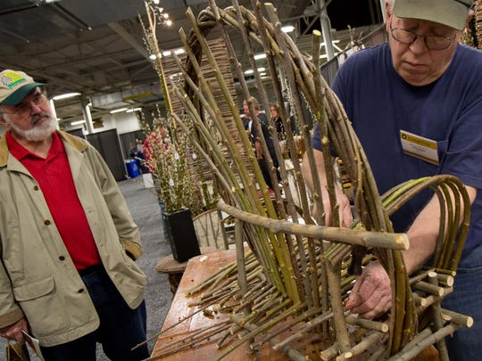 Greg Adams (right) made a willow chair during the Indiana Artisan Marketplace in 2014. This year's event will take place at the Indiana State Fairgrounds on March 25-26.