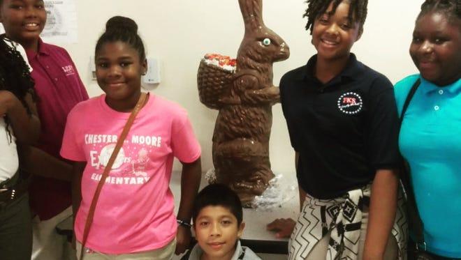 Club members Jaylen, Czaria, Luis, Dekeidra and A'layisia with the giant chocolate bunny