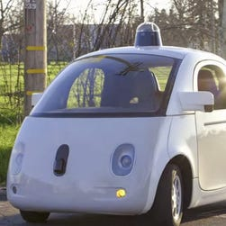 Google's new self-driving car has begun testing in the streets of Mountain View, Calif. The search company's Lexus SUV research cars once again were involved in accidents, but humans in other cars were again at fault, the company says.
