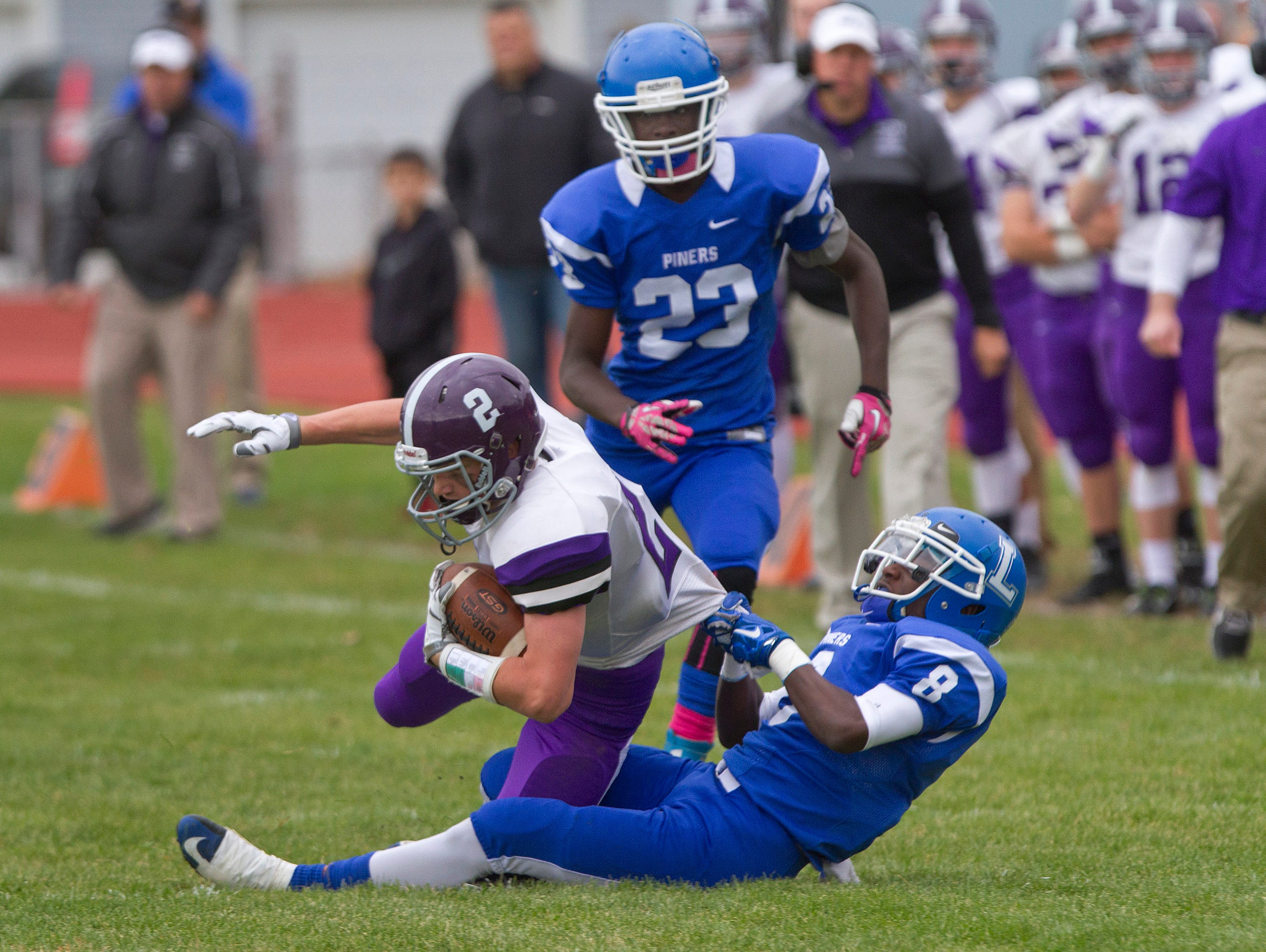 Lakewood's Honore Richardon wrestles Rumson's Lachlan Hull to the ground during Rumson-Fair Haven Football vs Lakewood in Lakewood, NJ on October 24, 2015