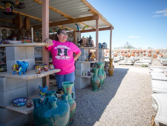 Maria Vasquez, visiting from Artesia, N.M., shops for