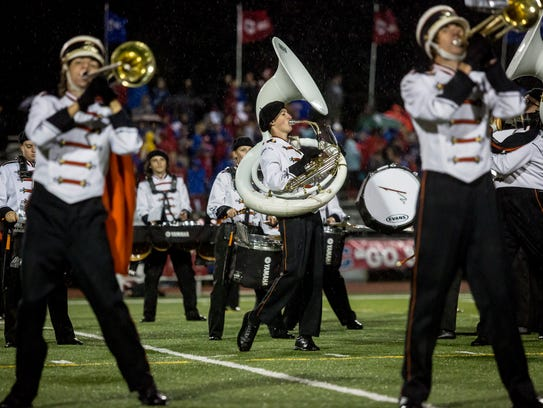 Members of the Marine City marching band perform during