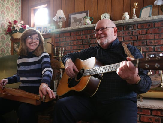 From left, Carol and Kevin Becker play a song at their