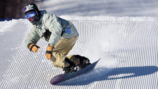 Jacob Tourville,18, Albertville, carves his way through the terrain park Saturday, Dec. 30, at Powder Ridge Winter Recreation Area in Kimball.