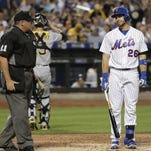 The Mets' Kevin Plawecki looks at home plate umpire Hunter Wendelstedt after striking out to end the fifth inning against the Pittsburgh Pirates Tuesday night at Citi Field in New York. The Pirates won 4-0.