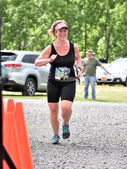 Chrissy Nelson, 40, of Marion, completes a half marathon