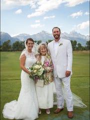 Bride Allie Baker,  and groom Ragan Baker flank his