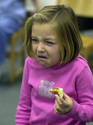 Columnist Chuck Stinnett says that while growing up , he periodically tried sorghum molasses, but usually puckered up in distaste. In this Gleaner file photo from 2002, Taylor Alexander, then 7, shows pretty much the same reaction. She and her classmates were sampling foods the pioneer children would have eaten as part of a class lesson at Bend Gate Elementary School.