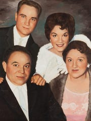 Family portrait of Connie, her brother and parents.