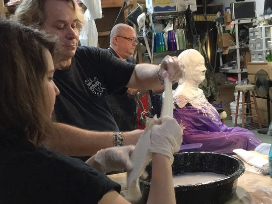 Ashley Green, Ray Asiala and Alan Ostrander of AEO Studios do a lifecast mold of Christina LaFortune's head.