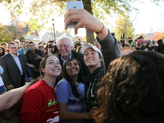 Sen. Bernie Sanders poses for a photo at College Green