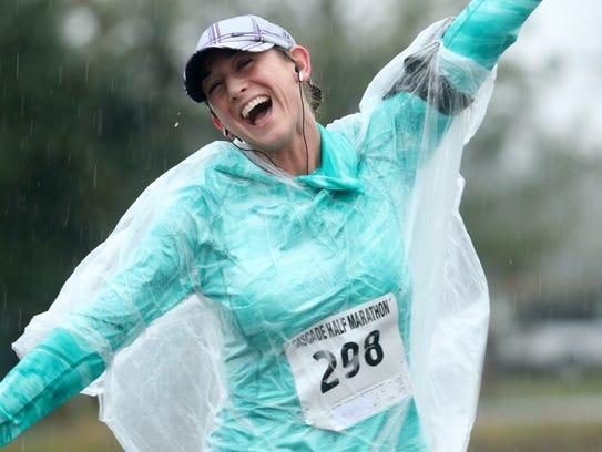 A racer runs in the rain during the Cascade Half Marathon in 2016.