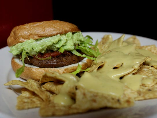 A guacamole burger with chips and secret quest sauce,