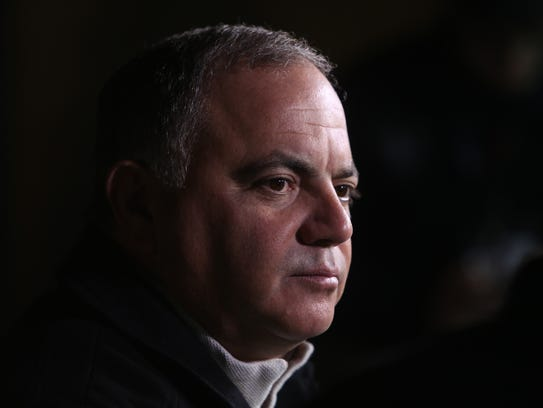 Tigers general manager Al Avila talks with reporters