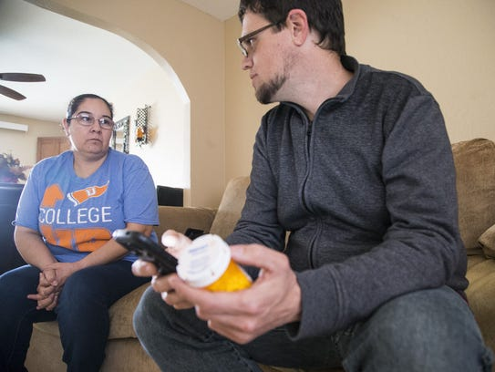 Jason Odhner brings medications to a patient named