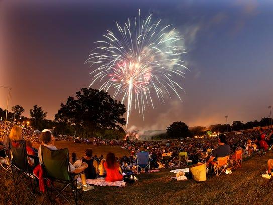 Fireworks burst over a filled Hart Park Saturday, July