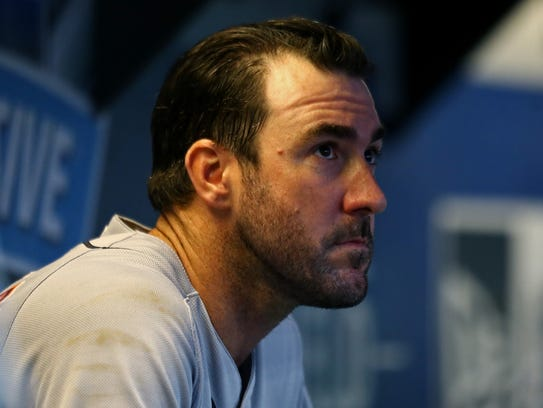 Tigers pitcher Justin Verlander (35) sits in the dugout